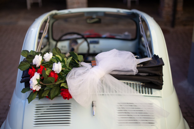 overhead-shot-bouquet-flowers-placed-top-car-with-blurred-background_181624-9427